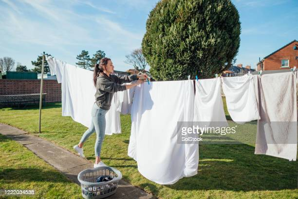 working on household chores - washing stock pictures, royalty-free photos & images