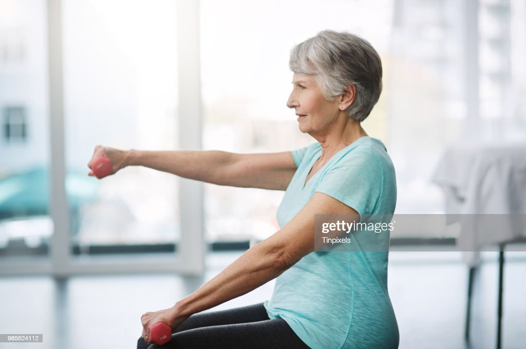 Working on keeping herself healthy : Stock Photo
