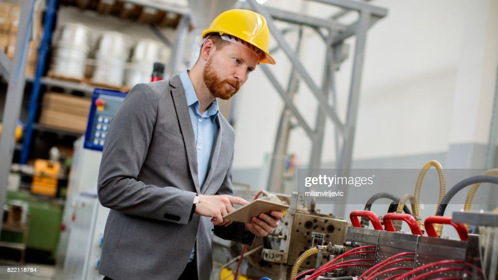Working on machines in factory : Stock Photo