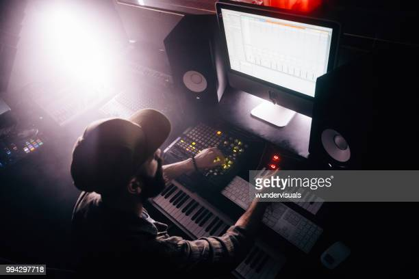dj working on professional audio equipment and producing music - post-production stock pictures, royalty-free photos & images