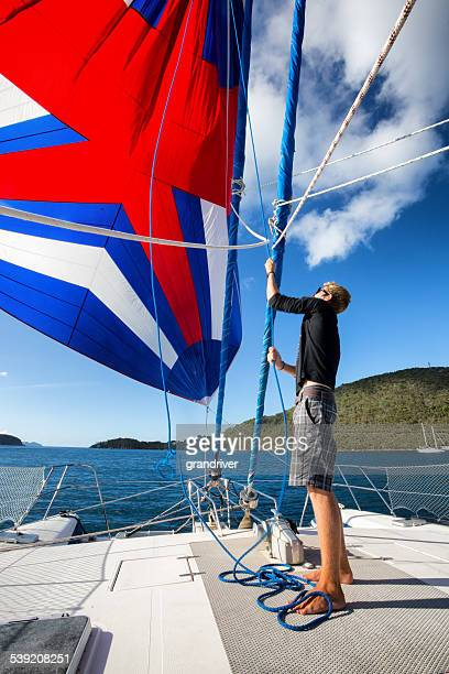 working on sails - isle of wight stock pictures, royalty-free photos & images