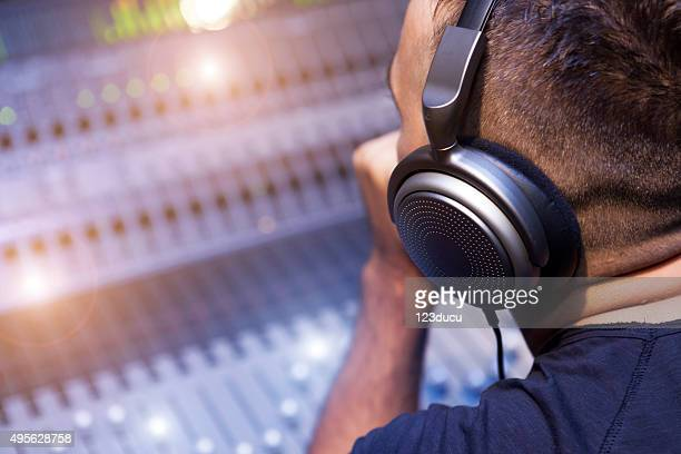 working on sound mixer - post-production stock pictures, royalty-free photos & images