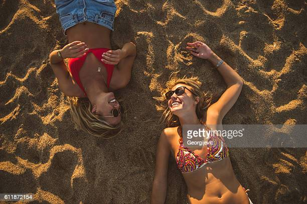 working on that tan - girls sunbathing stock photos and pictures