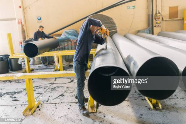 working on the big pipe in factory - pipeline stock pictures, royalty-free photos & images