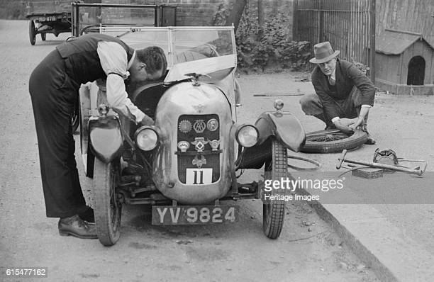 Working on the engine of E Martin's Austin Swallow at the North West London Motor Club Trial 1929 Austin Swallow 2seater 747 cc Vehicle Reg No YV9824...