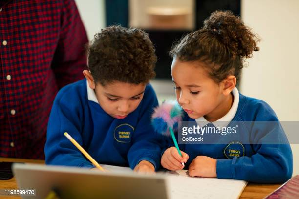 working on their writing - preschool child stock pictures, royalty-free photos & images