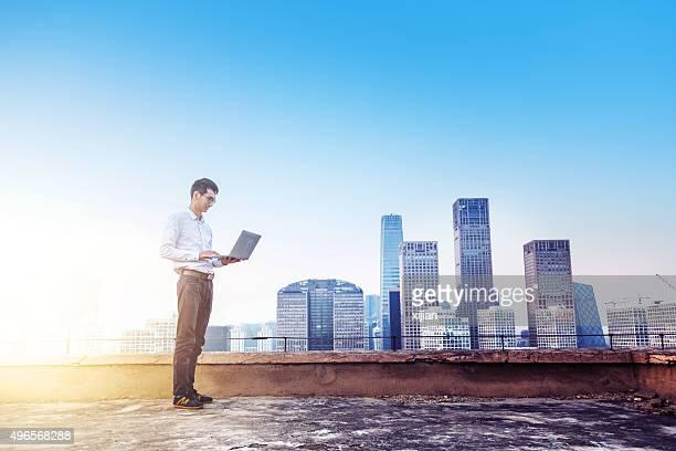 Working on top of city skyline