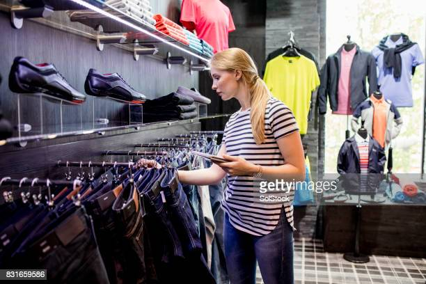 working online in a department store - menswear stock pictures, royalty-free photos & images