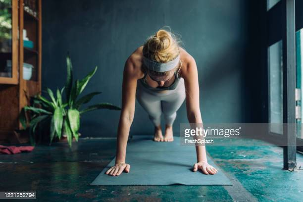 working out at home: beautiful fit blonde woman doing a plank - plank position stock pictures, royalty-free photos & images