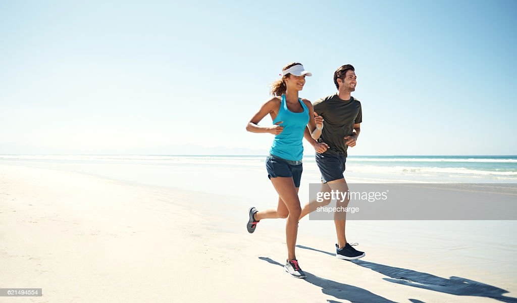 Working out by the ocean : Stock Photo