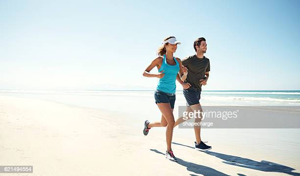 working out by the ocean - running stock pictures, royalty-free photos & images