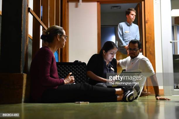 Working out of a suitcase they call their mobile office from left Robin Reineke Mirza Monterroso Arturo Magana and Ben Clark all with the Colibri...