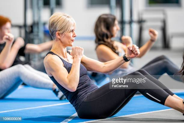 working out together in a class - exercising stock pictures, royalty-free photos & images