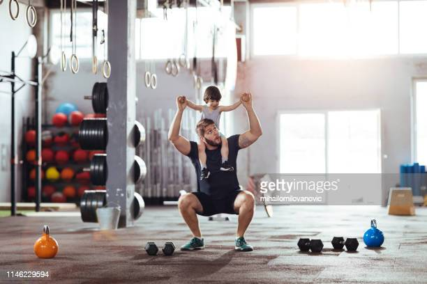 working out together - picking up stock pictures, royalty-free photos & images