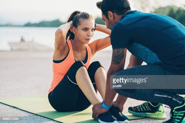working out together - arab feet stock photos and pictures