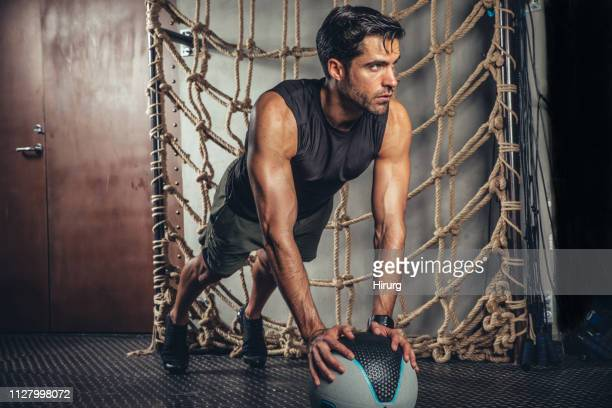 working out with medicine ball - medicine ball stock pictures, royalty-free photos & images