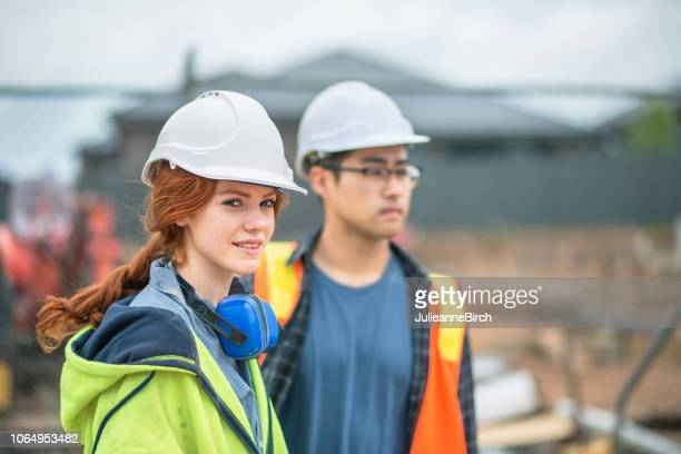 working outdoors in all weathers, tough work in construction industry - trainee stock pictures, royalty-free photos & images