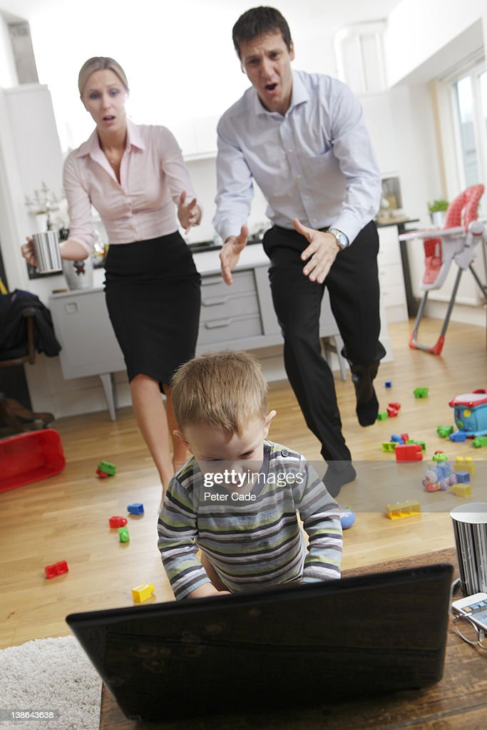 Working Parents Rushing To Stop Child On Laptop High-Res ...