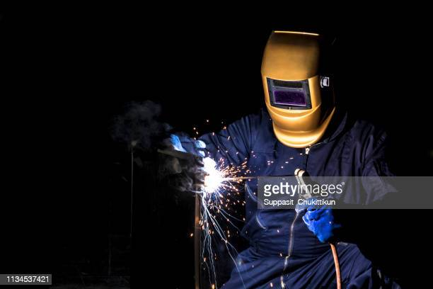 working person about welder steel. - male erection stock pictures, royalty-free photos & images
