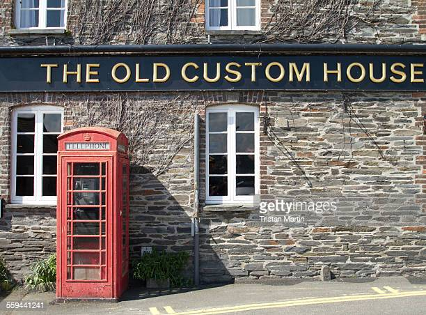 Working public phone box outside The Old Custom House beside the harbour in Padstow Cornwall England