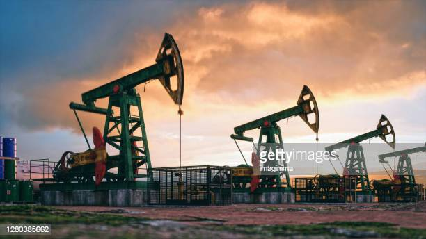working pumpjacks on sunset - gasoline stock pictures, royalty-free photos & images