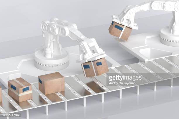 working robotic arms - robot stock pictures, royalty-free photos & images