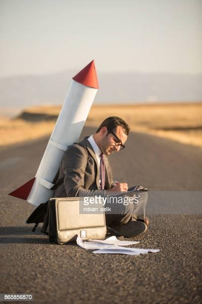 Working rocket business man