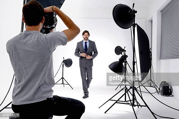 working that studio! - photographer stock photos and pictures