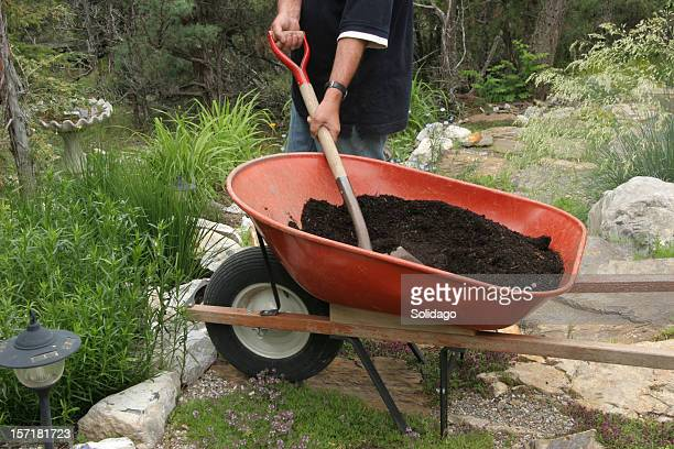 working the soil in the country - loam stock photos and pictures