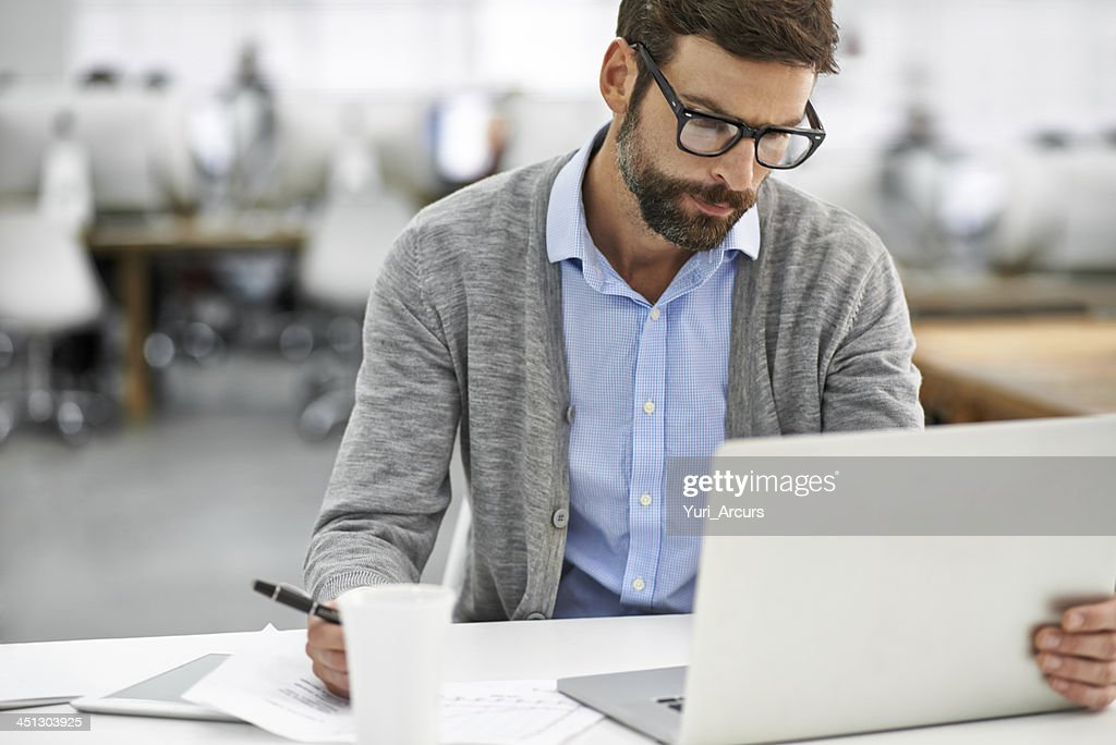 Working through the finer details : Stock Photo