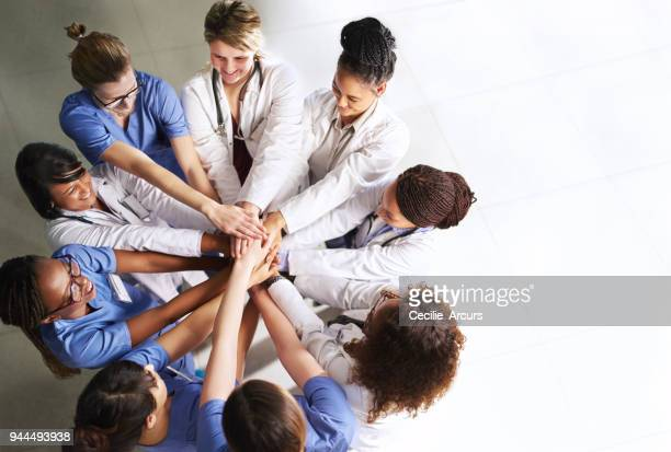 working together for the betterment of your health - group of doctors stock pictures, royalty-free photos & images
