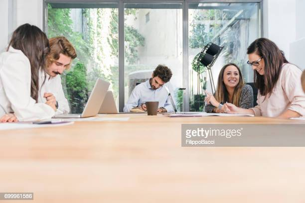 working together in a new business company - real estate office stock photos and pictures