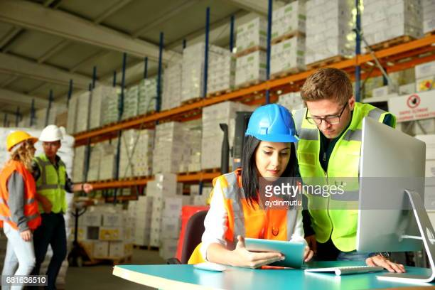 working together in a warehouse - heavy industry stock photos and pictures