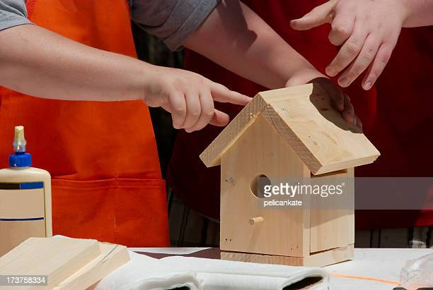 working together to build a bird house - birdhouse stock pictures, royalty-free photos & images