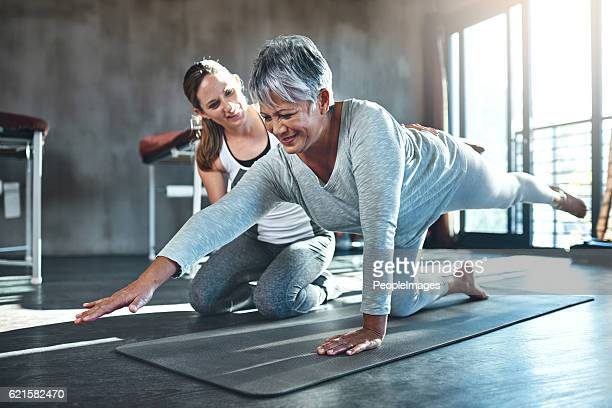 working together to improve muscle strength and tone - bounce back stock photos and pictures