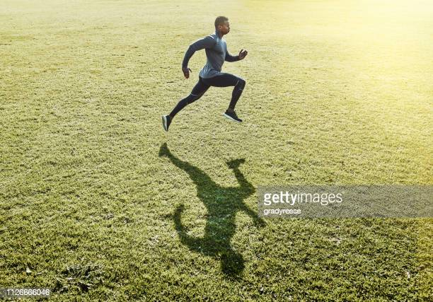 working up a sweat - sprinting stock pictures, royalty-free photos & images
