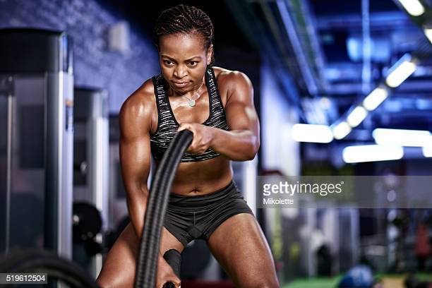 working up a sweat - black female bodybuilder stock photos and pictures