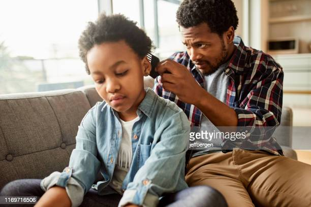 working very carefully - braided hair stock pictures, royalty-free photos & images
