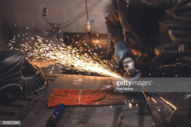 working with grinder tool - welding stock photos and pictures