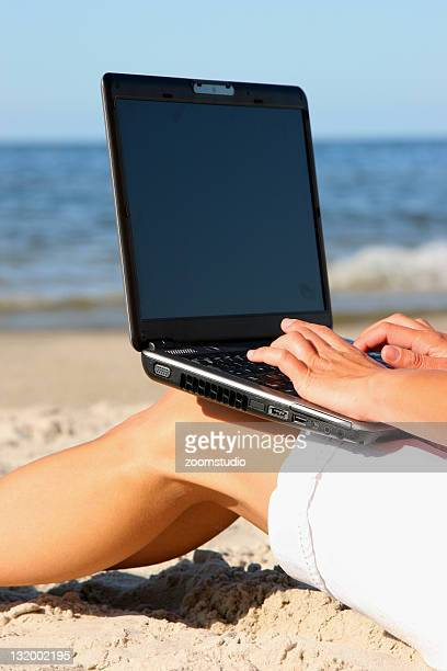 Working with laptop at beach