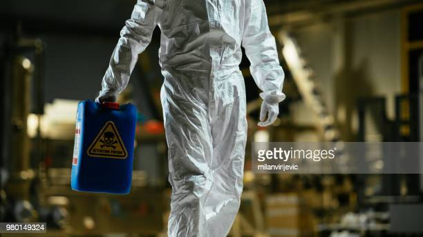 working with radioactive materials - epidemic stock pictures, royalty-free photos & images