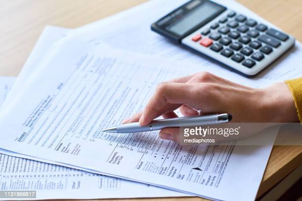 working with tax return form - accountancy stock pictures, royalty-free photos & images