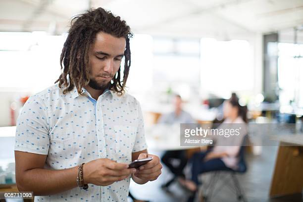 working with technology in modern office - dreadlocks stock pictures, royalty-free photos & images