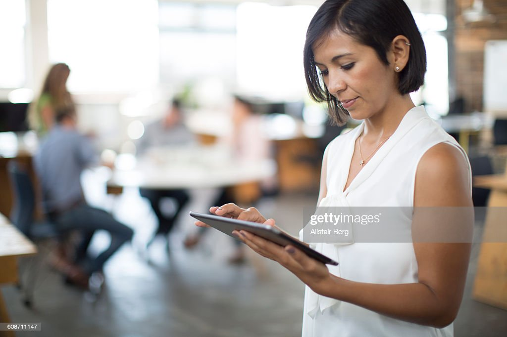 Working with technology in modern office : Stock Photo