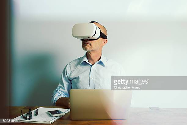 Working with Virtual Reality Headset Laptop and Smartphone