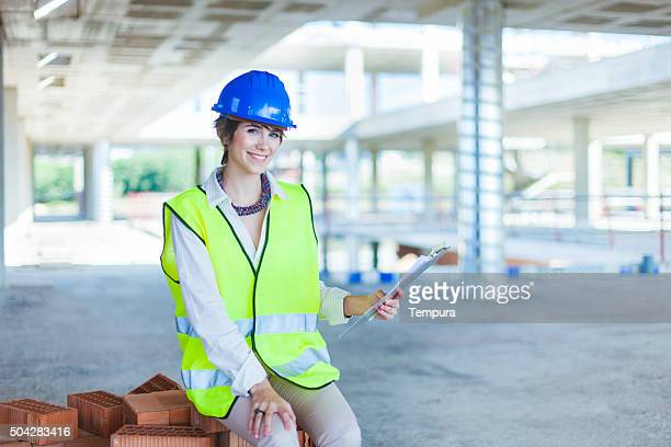 Working woman in a construction site.