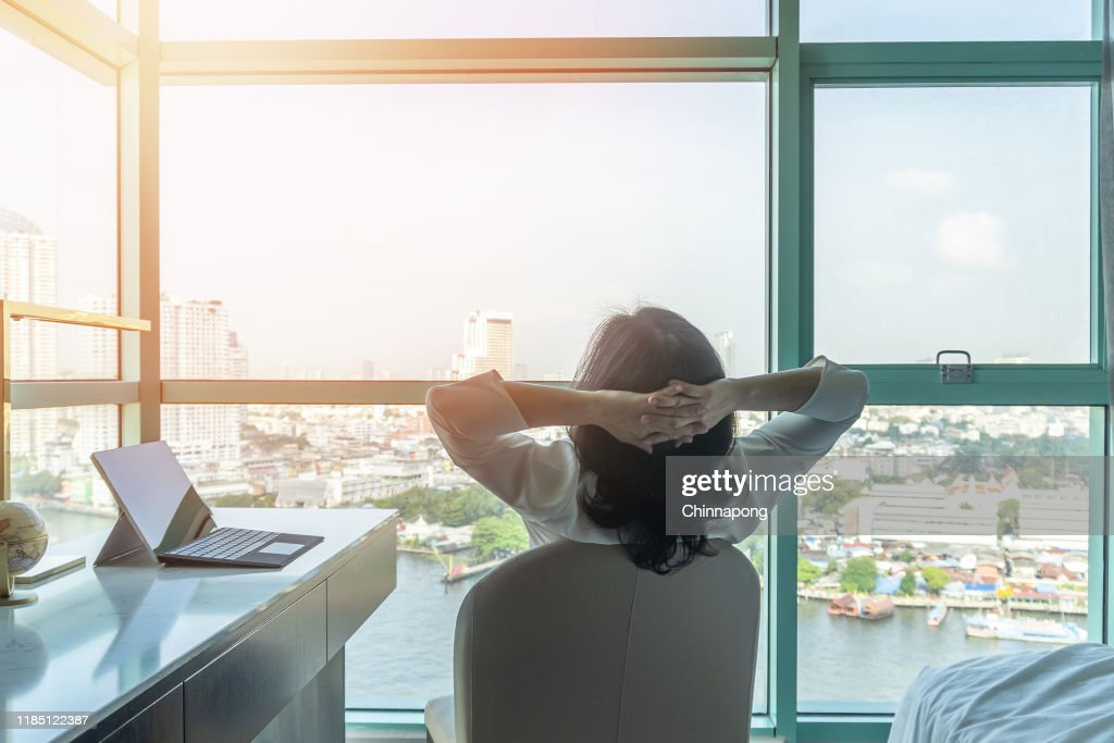 Work-life balance relaxation with Asian working business woman healthy lifestyle take it easy resting in comfort hotel or home living room having free time with peace of mind and self health balance : Stock Photo