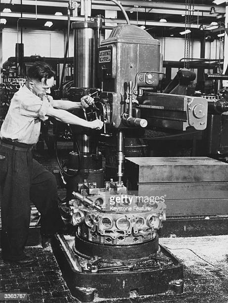 A workman at the Wright Aeronautical Machine Shop drills a supercharger rear housing one of the components of an aircraft Cyclone engine The company...