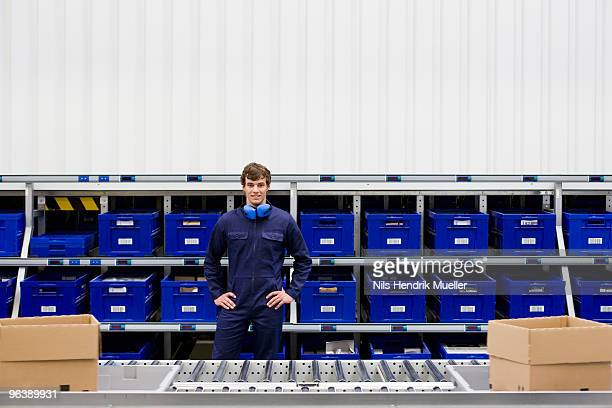 workman at workplace - industrial storage bins stock pictures, royalty-free photos & images
