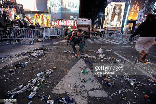 Workman begin the task of cleaning up after thousands of revelers gathered in New York's Times Square to celebrate the ball drop at the annual New...